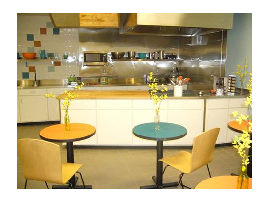 "Activity in a Lively Demonstration Kitchen is Visible from the Circulation ""River"""