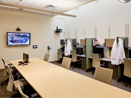 Graduate Dental Student work area and study hall. 10 workstation plus conference table.  The monitor is connected to the ORs.