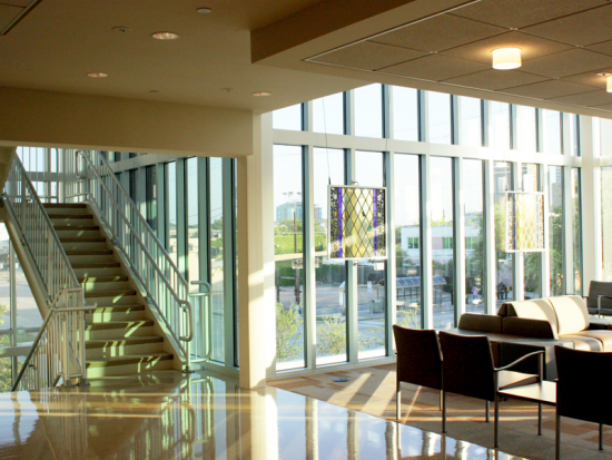 Main staircase and Adult Medical waiting area with views of Downtown Houston